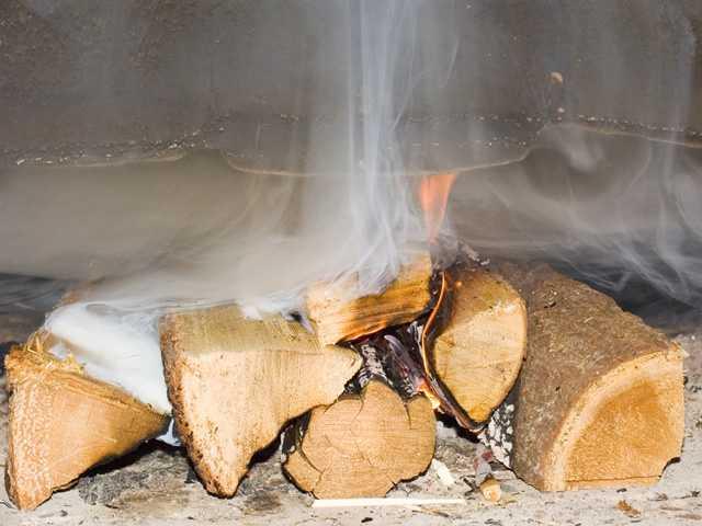 Чем почистить кирпичный дымоход: механические и химические средства
