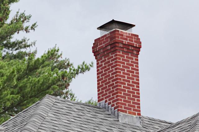 Обкладка дымохода кирпичом: преимущества, ход работы