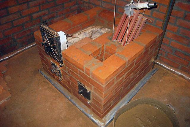 Кирпичная печь с водяным контуром: как установить